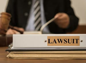 Filing a workers' compensation claim bars you from filing a lawsuit against your employer.