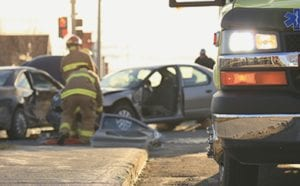 Firefighters helping victims of a car accident
